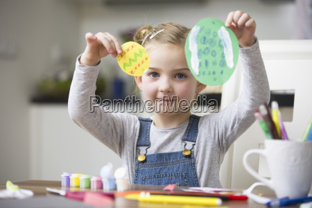 portrait of young girl holding up