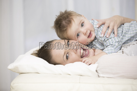 baby boy lying with mother and