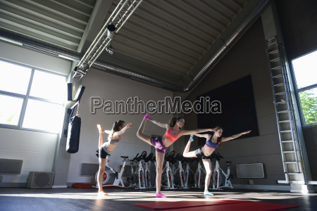 teenage girls in yoga pose in