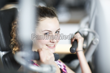portrait of teenage girl in gym