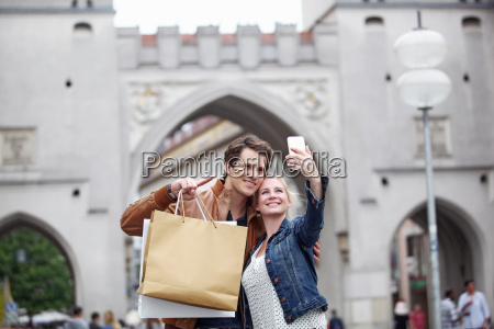 mid adult couple taking selfie in