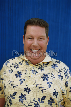 portrait of overweight man smiling