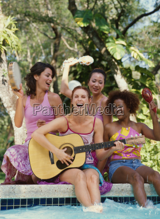all girl band performing outdoors