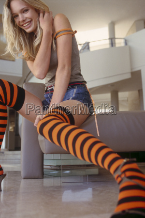 young woman wearing striped knee high