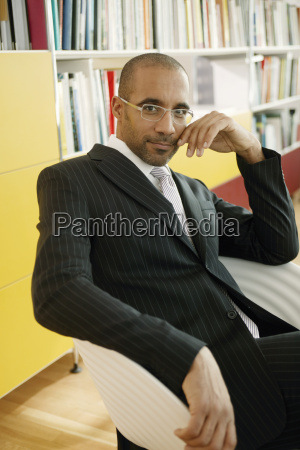 view of a businessman posing for