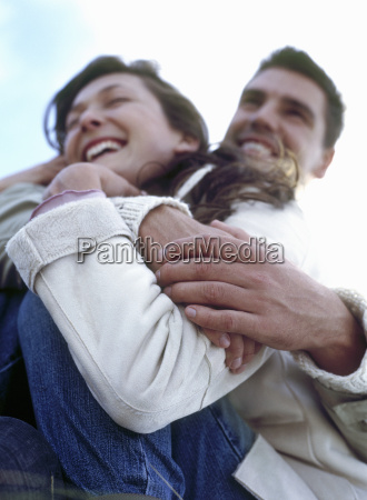 low angle view of couple embracing