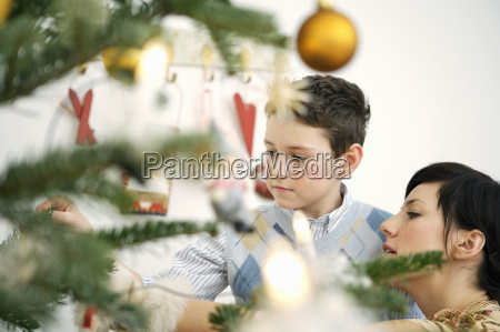 mother and young son decorating christmas
