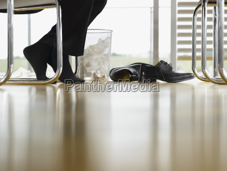 close up of businessmans feet with