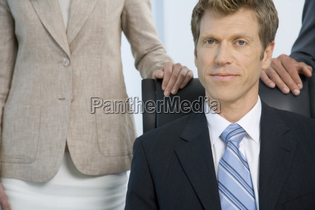businessman sitting at desk with co