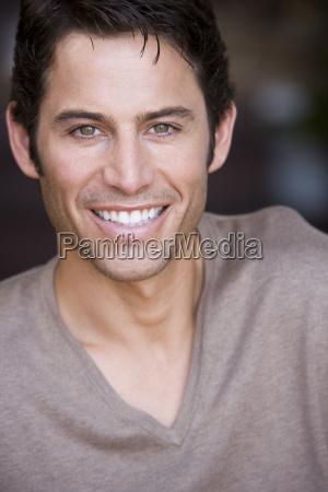 close up of man smiling