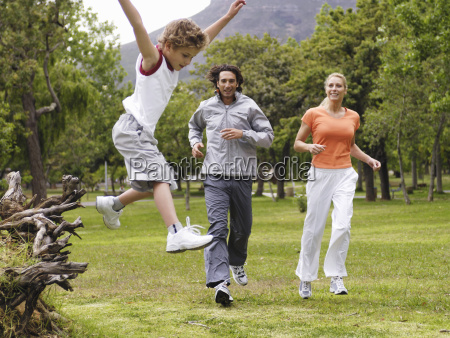 family exercising in park