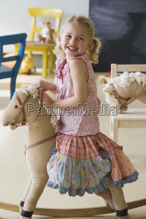preschool girl on rocking horse