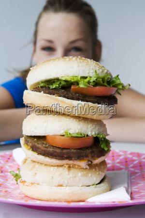 close up of hamburgers with teenage