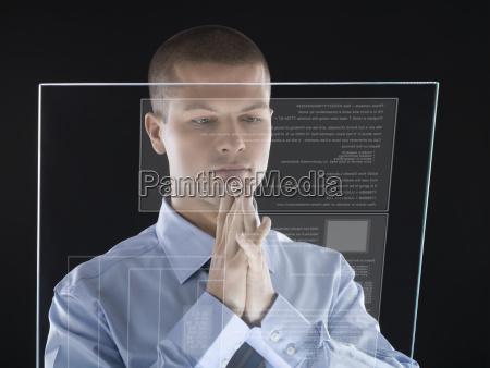 man looking at interactive display