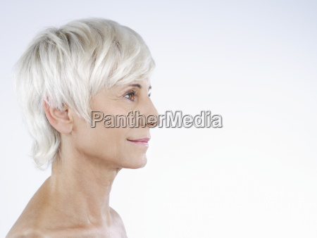profile of nude senior woman