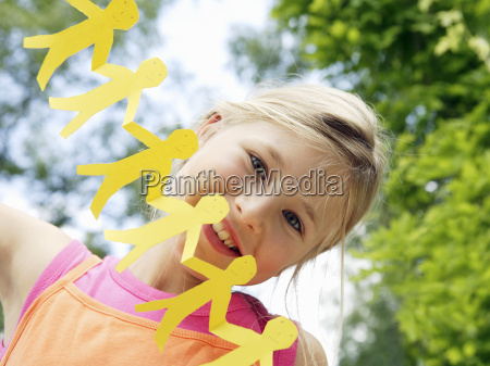 young girl with paper cut out