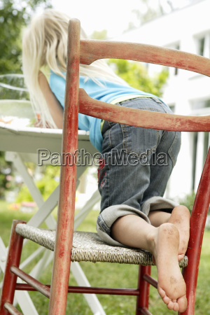 rear view of young girl sitting
