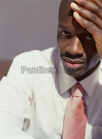 african american businessman resting head on