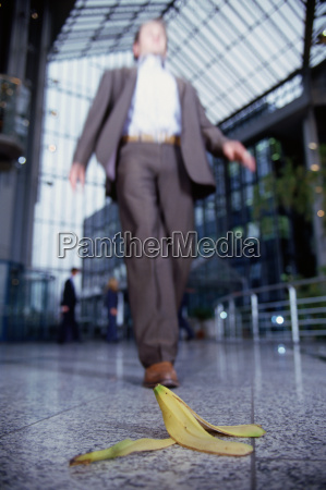 businessman about to step on banana