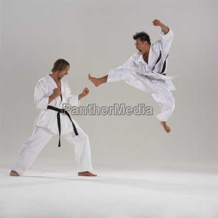 two men in karate competition one