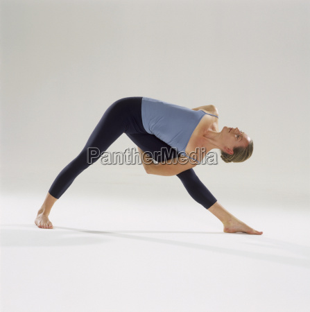 woman doing yoga stretching to one