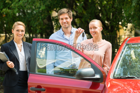 happy young couple with key of