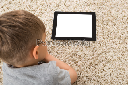 close up of boy and digital
