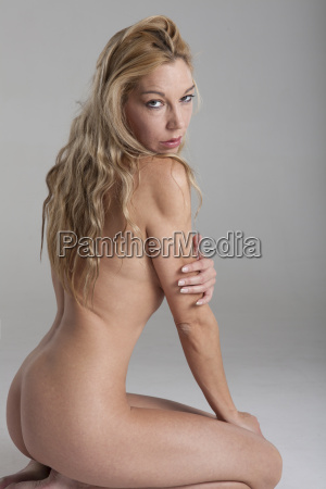 blonde naked woman on gray background