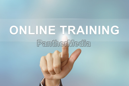 business hand clicking online training button