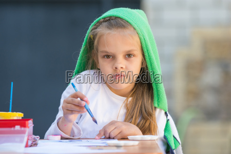 thoughtful and enthusiastic girl draws a