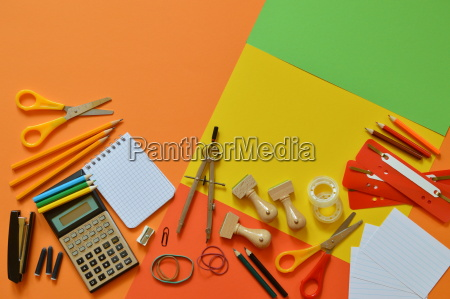 school supplies on colorful paperboard as