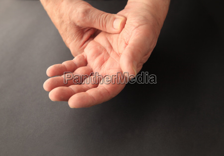 painful hand of senior man