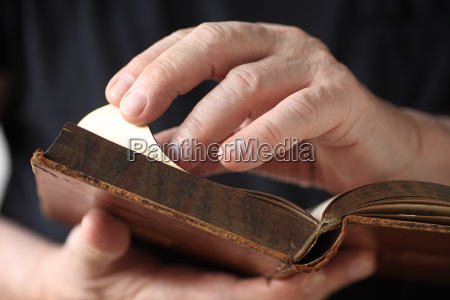 older man looks at vintage book