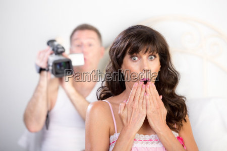 couple with video camera in the