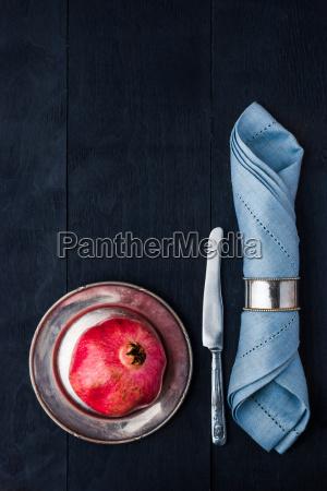 pomegranate on the vintage metal