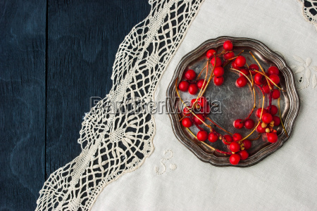 red berries on the old metal