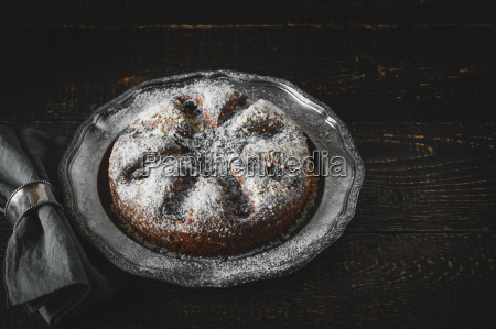 cake with icing sugar with napkin