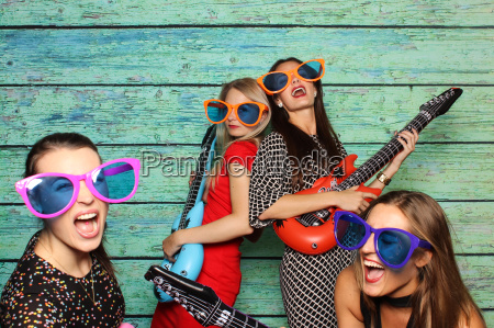 girl group with plastic guitars before