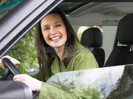 woman in a car smiling