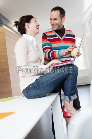 couple looking at notebook