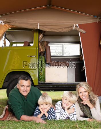 family in front of camper van