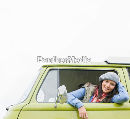 smiling woman looking of camper van