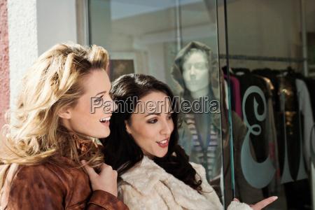 two female friends window shopping