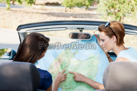 two women reading a map in
