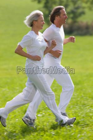 couple running in field