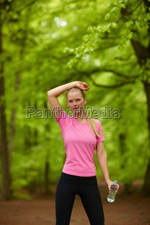 woman running standing still with water