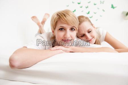 women lying on bed