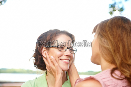 woman holding another womans head in