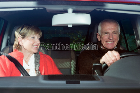 senior couple in car