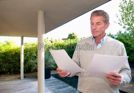 senior business man reads data